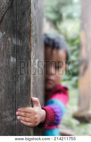 Bumthang, Bhutan - September 14, 2016: Child Hand Holding The Door In A Village In Bumthang Valley,