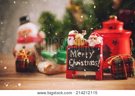 Christmas holiday background with Santa and decorations. Christmas landscape with gifts and snow. Merry christmas and happy new year greeting card with copy-space. Christmas celebration holiday background.