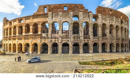 Rome, Italy - May 12, 2016: sunset with clouds and tourists visiting the Colosseum, Flavian Amphitheatre, the largest amphitheater in the world and one of the symbols of Italy and Rome.