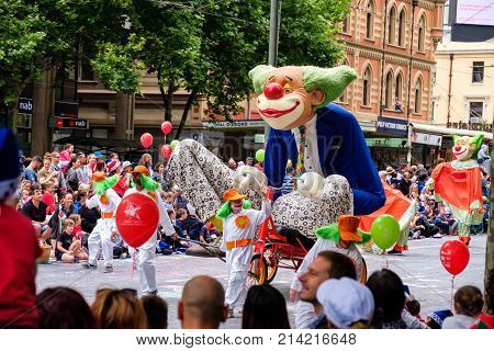 Adelaide Australia - November 18 2017: Parade participants walk along crowd of people during Adelaide's 85th Credit Union Christmas Pageant parade