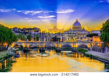 Sunset view of the Vatican with bridges over the Tiber river, Rome, Italy