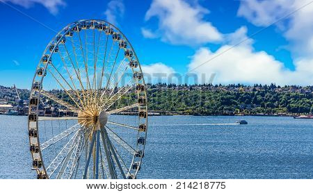 Puget Sound with Ferry Past Seattle Ferris Wheel