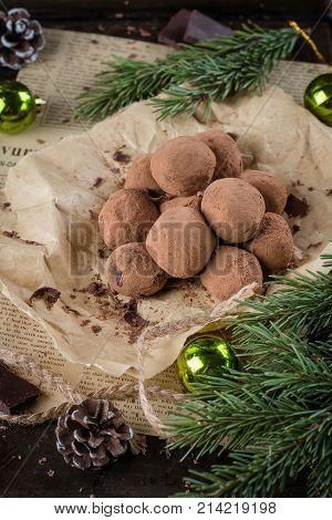 Homemade Chocolate Truffles On The Paper On Stone Concrete Table Background With Festive Holiday Dec