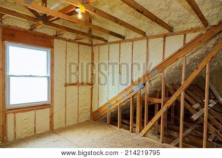 A Room At Newly Constructed Home Is Sprayed With Liquid Insulating Foam