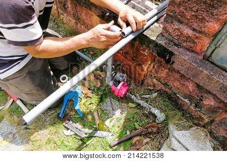 Series Of Plumber Fixing Installing Oudoor Valve Meter Piping
