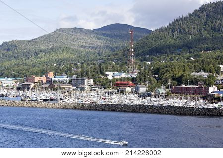 The motorboat passing by the marina of Ketchikan town (Alaska).