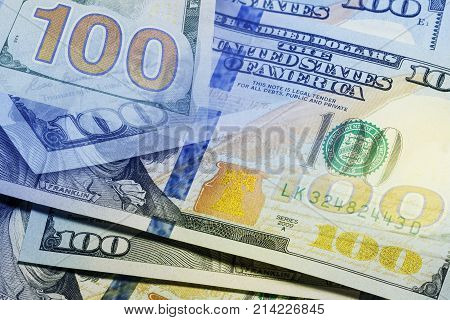Conceptual view on One hundred dollar banknotes stack close up with selective focus