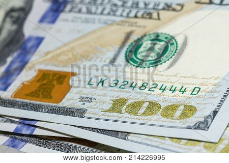 One hundred dollar bills close up with selective focus