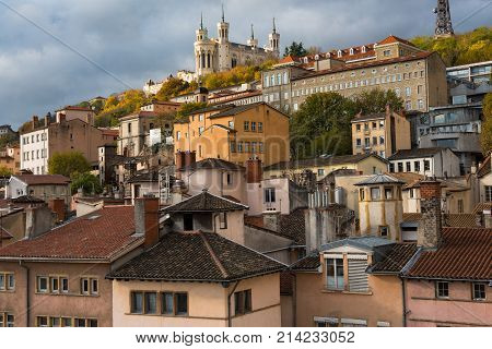 Lyon France--November 6 2017--Dwellings around the Old City section of Lyon. The Basilica of Notre-Dame de Fourviere is at the top of the hill. Editorial Use Only.