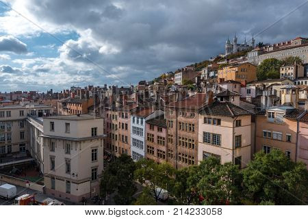 Lyon France--November 6 2017--Overlooking the Old City section of Lyon. The Basilica of Notre-Dame de Fourviere is in the background at the top of the hill. Editorial Use Only.