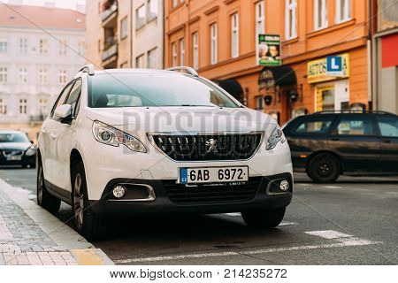 Prague, Czech Republic - September 23, 2017: Front View Of White Peugeot 2008 Car Parked In Street. Mini Sport Utility Vehicle Produced By French Manufacturer Peugeot Since 2013
