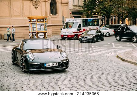 Prague, Czech Republic - September 23, 2017: Front View Of Black Porsche 991 Targa 4S Car Moving On Street. Car Of Second Generation