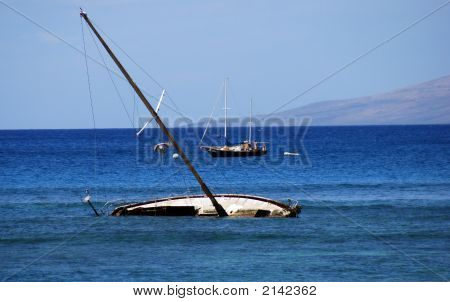 capsize sailboat of maui shoreline with othere boat in the background poster