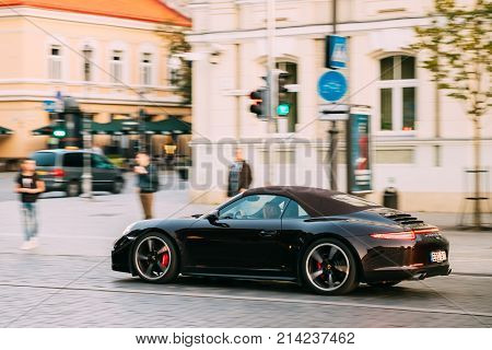 Vilnius, Lithuania - September 29, 2017: Side View Of Black Porsche 991 Targa 4S Car Moving On Street. Car Of Second Generation