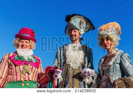 Disguised People At The Carnival Of Venice