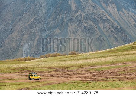 Stepantsminda Gergeti, Georgia - May 23, 2016: Land Rover Discovery Suv Car On Off Road In Spring Mountains Landscape In Georgia. Mid-size Luxury Suv, From The British Car Maker Land Rover