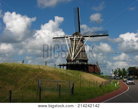 Old Wind mill in Netherlands Sonny sommer day