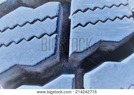 Tire tread from an earth mover, closeup and tinted blue