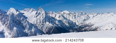 Snow Covered The Ski Slopes Against The Backdrop Of The Mountain Peaks.