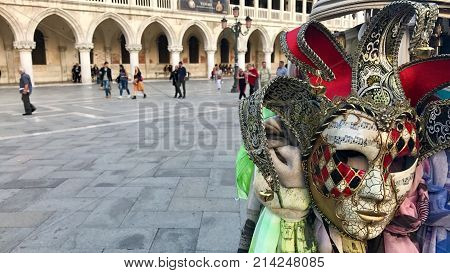 Doge's Palace and famous venetion masks at San Marco square, Venice, Italy