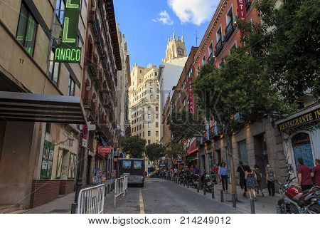 MADRID, SPAIN - MAY 24, 2017: The Las Tres Cruses Street is one of the typical old small streets in the city center next to Puerta del Sol.