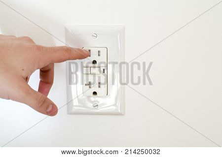 Finger Dangerously Close To Electrical Socket