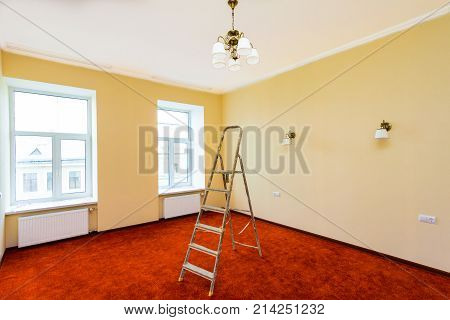 Interior of upgrade apartment with ladder after the remodeling renovation extension restoration reconstruction and construction(making wall from gypsum plasterboard wonder carpet or flooring roll)