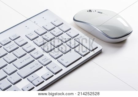 Close-up of white Computer input devices on White