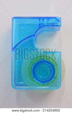 Blue plastic adhesive tape holder. Adhesive tape.