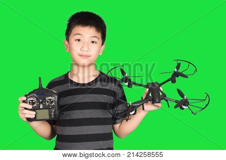 Asian Boy Holding Drone And Radio Remote Control Handset For Helicopter, Drone Or Plane, Isolated On