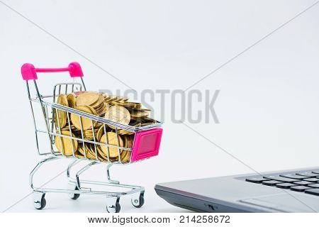 Shopping Cart Or Supermarket Trolley With Laptop Notebook On White Background, E-commerce And Online