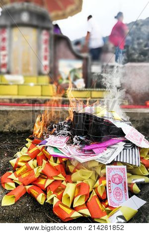 Chinese Taoism Tradition Burn Paper Money And Gold To Ancestors