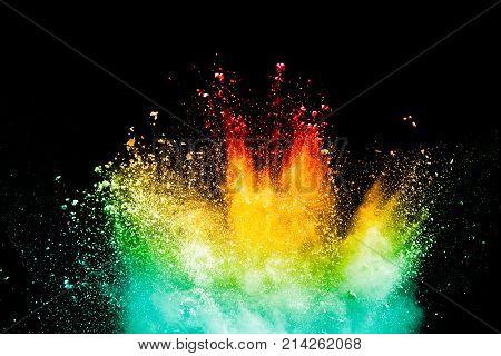 color powder explosion on black background. Mauve color cloud. color dust explode. Freeze motion paint Holi.
