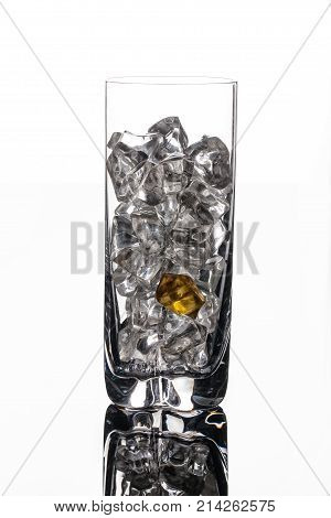 Crystals of ice in a glass with water on a glass background