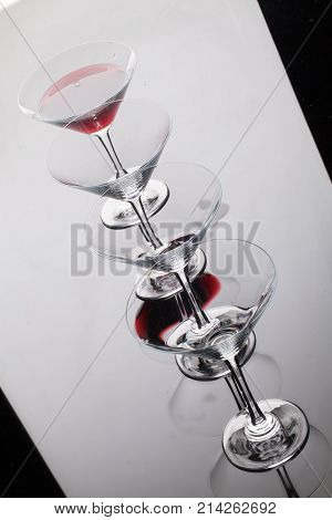 Glass with a red wine on a glass studio background