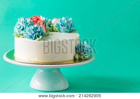 Cute Cake On Cake Stand On Green Background