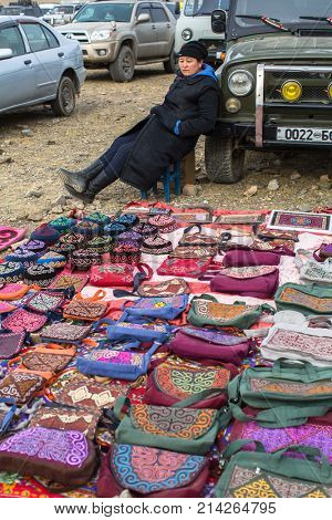 OLGIY, MONGOLIA - SEP 30, 2017: Street sellers mongolian handicrafts during annual national competition with birds of prey