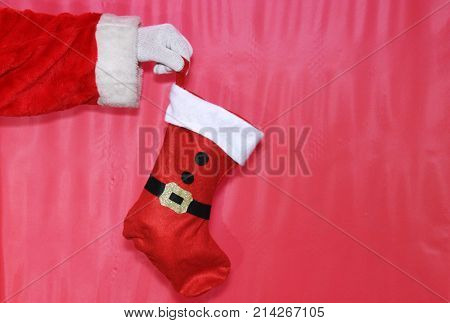 santa claus hand holds a Christmas stocking