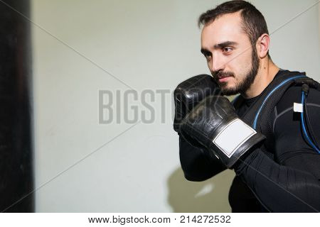 Man In Boxing Gloves In The Rack.
