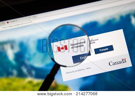 MONTREAL CANADA - NOVEMBER 17 2017: Official web page of Canadian Government under magnifying glass where every user can find information about Canadian Government and its Departments and services.