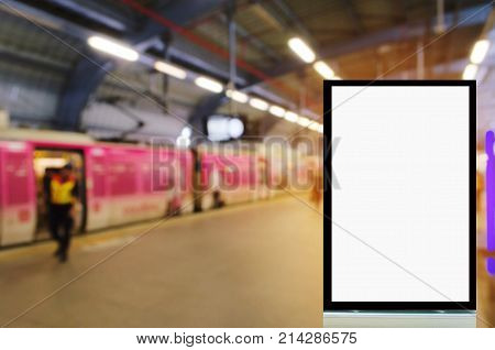 blank advertising billboard or showcase light box with copy space for your text message or media content with people in subway train station background advertisement commercial and marketing concept