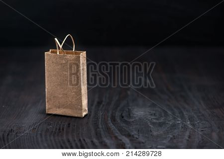 Single Paper Bag On Wooden Background, Concept Of China Single Day