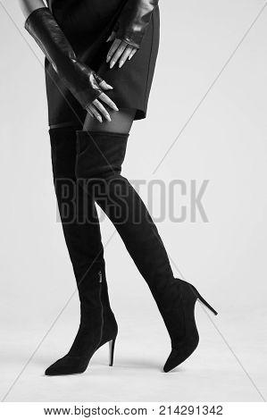 Girl in Hessian boots in high heels in studio