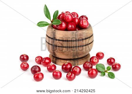 Cranberry with leaf in wooden bowl isolated on white background closeup.