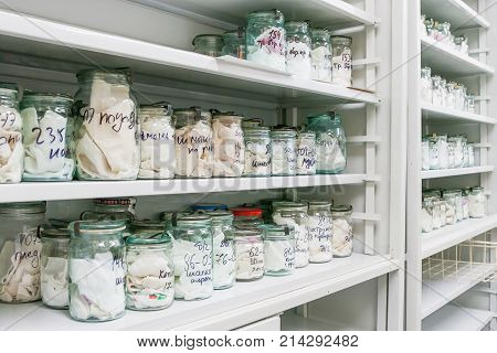 MOSCOW RUSSIA - June 24 2009. Glass jars with rags inside - samples of human blood and sweat. Shelves with material evidences in laboratory of examination human olfactory traces.