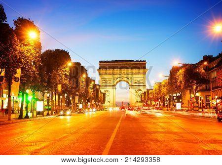 Arc de Triomphe and Champ Elysees at night, Paris, France, retro toned