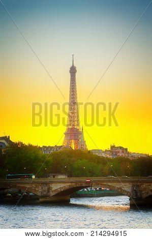 Eiffel tower over Alexandre III Bridgeat at sunset, Paris, France, retro toned