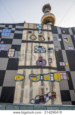 VIENNA, AUSTRIA - JULY 18,  2014: The District heating plant in Vienna designed by the famous Austrian architect Friedensreich Hundertwasser. Wide-angle view.