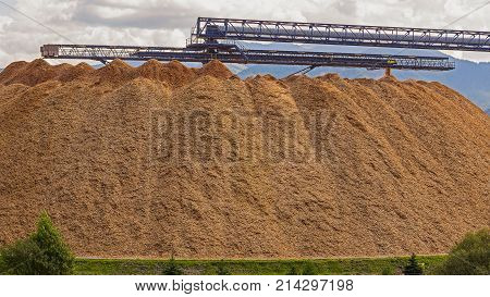 Large wood chip processing facility in the mountains.