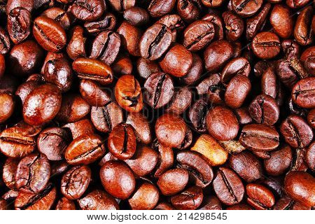 Coffee texture. Roasted coffee beans as background wallpaper. Beautiful arabica real cofee bean illustration for any concept. Gourmet coffee beans macro closeup studio photo. Delicous food photo.